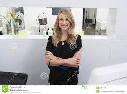 business owner beauty salon stock photos images pictures 560 hairstylist standing arms crossed at reception in salon stock photography