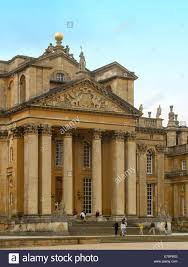 england style steps: grand entrance to blenheim palace with tall columns and gothic style architecture and tourists on wide steps in england