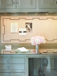 chic small office nook design with gray green cabinets built in glass top desk and nailhead trim bulletin board bulletin board design office