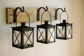 wood sign glass decor wooden kitchen wall: black lantern trio wall decor home decor rustic decor hanging from wrought iron hooks on wood board