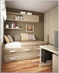 space saving ideas for small bedroom with brown varnishes teak wood single bed which has trundle bedroom photo 4 space saver