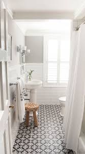 white bathroom floor: absolutely beautiful bathroom features upper walls painted gray sherwin williams gray clouds and lower walls clad in white brick tiles lined with an oval