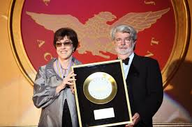 nora ephron academy of achievement awards council member and filmmaker george lucas presents nora ephron the golden plate award at