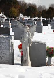 brooklyn suit murdered w s casket popped open in grave ny a statue of an angel stands on the unmarked grave in rosehill cemetery in linden