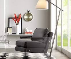 see through acrylic furniture lends a light and airy feel to this living room charm impression living room lighting ideas