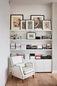 magazine rack wall mount: interior design book rack white sofa wooden floor books paintings white wall mounted magazine rack