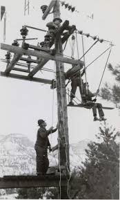 tough men work tough jobs to turn on the lights 1929 installing dead end clamps at the rockwood switch tower