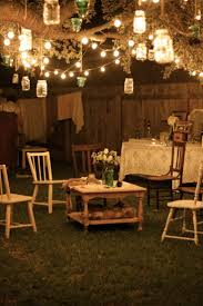 the lighting is spectacular yet organic what a cozy backyard party lighting