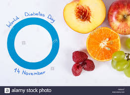 fresh ripe fruits and blue circle of paper symbol of world fresh ripe fruits and blue circle of paper symbol of world diabetes day and healthy nutrition white background