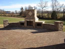 outdoor fireplace paver patio: edina landscape concrete freestanding custom retaining wall paver patio and fireplace in wildwood  l
