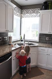 sink windows window love: kitchen corner window valance love the back splash
