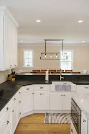 white cape cabinets eastman st woodworks kitchen in marthas vineyard photographed by cleme