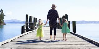 life as a single mom essay   what you dont know until youre a  mom hold hands with two small daughters on a pier