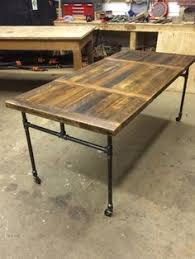 dining table with wheels: dining table handmade from reclaimed fir salvaged from a local barn legs are custom made