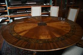 dining room round glass table set set2 inch drop in leaves reclaimed barn wood brown iron chandelier barn board