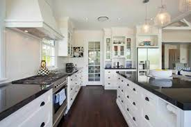 Small Picture White Kitchen Cabinets With Granite Countertops And Dark Floors