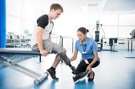 <b>Physiotherapist</b> Explaining To Young <b>Man</b> With Prosthetic Leg ...
