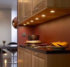under shelf lighting. modern tiny kitchen design with cabinet lighting over black granite countertop also walnut under shelf