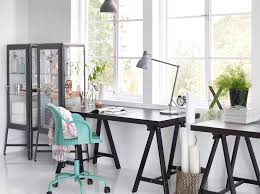 a home office with tornliden desk in black black fabrikr glass cabinet and roberget swivel chic ikea home office