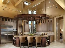countertops dark wood kitchen islands table: this corner kitchen features unique dark wood overhang supporting lighting with matching triangular island topped