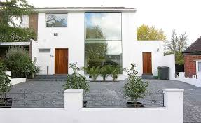 Things You Can Do Without Planning Permission   Homebuilding    Front view of a remodelled s home   large glass elevation  You don    t normally need planning permission