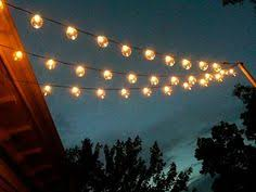 i love this look of lights over the deck she gives directions on how she backyard string lighting
