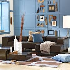 love the blue walls with brown couch especially the wall decor collection brown furniture living room ideas