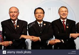 minister of trade warren truss l joins hands his minister of trade warren truss l joins hands his counterparts peter favila c and s phil goff after a meeting at