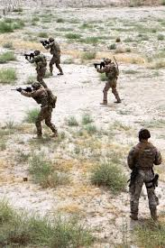 u s department of defense photo essay a range safety officer lower right observes as u s iers participate in partnered