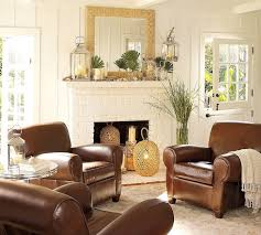 classic living room with white brick fireplace and brown leather sofa on cream rug combined with barn living rooms room