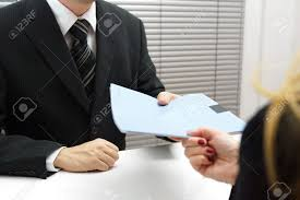 employment interview female applicant handing over a file employment interview female applicant handing over a file containing her curriculum vitae to the businessman
