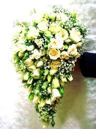 Traditional cream <b>rose</b> and gypsophila shower <b>bouquet</b> featuring ...