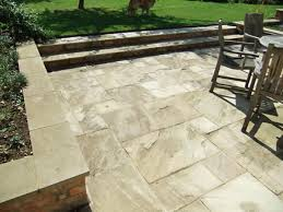 patio slab sets: there are many types of paving slabs and block paving from which to choose and the design can include decorative sets of your choice