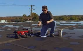 roof repair place: if using a pressure sensitive epdm repair patch remove backing and press into place