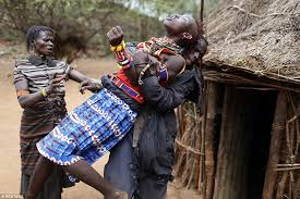 inside the     traditional     tribal wedding ceremony that still takes    struggle  a girl from the pokot tribe in kenya tries to escape after being