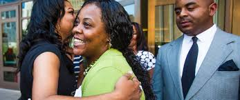 arizona mom who left kids in car for job interview glad for 2nd photo shanesha taylor is hugged as rev jarrett maupin looks on outside maricopa