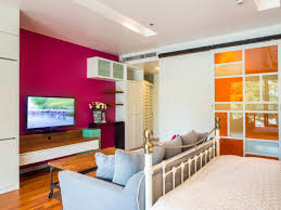 big master bedrooms couch bedroom fireplace: a modern bedroom with vintage furniture with a bold use of pink and orange color in