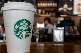 starbucks com paper cup in a starbucks coffee shop during the third