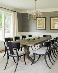 transitional dining chair sch: transitional dining room features upper walls clad in gray grasscloth and lower walls clad in wainscoting