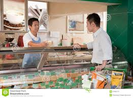 s clerk assisting man at the deli counter beijing stock s clerk assisting man at the deli counter beijing