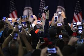 covering politics in a post truth america institution donald trump supporters hold up their phone cameras as they wait for the republican presidential nominee to arrive at a campaign rally in manassas