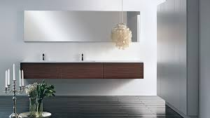 pendant modern bathroom lighting with large frameless mirror above wall mounted bathroom vanityy also laminate bathroom contemporary lighting