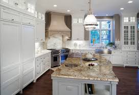 kitchen island granite top sun: crisp white shaker cabinetry with a contrasting island topped with bordeaux dream granite creates a warm and inviting space
