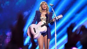 Taylor Swift Kicks Off 2019 VMAs With Colorful Performance ...