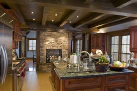 inspired kitchen cdab white brown: rustic look in this room is granted by exposed ceiling beams rich wood tones on