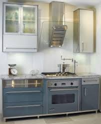 st charles kitchen cabinets: a blue range with matching cabinets on either side creates a cooking center that enlivens a