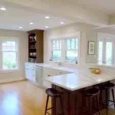 calacatta marble kitchen waterfall: kitchen with creamy calacatta marble countertops
