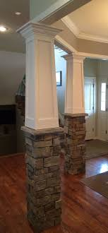 country kitchen column spout: tapered craftsman columns with stone base built over existing fiberglass columns