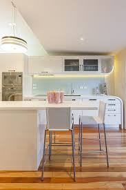 art deco renovation trendy kitchen photo in auckland with stainless steel appliances art deco kitchen lighting