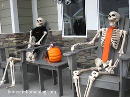 love halloween window decor: honey amp i often sit on these chairs on the front porch i told him these were our likeness in a few years ha
